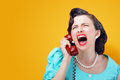 Angry woman screaming on the phone vintage shouting into telephone Royalty Free Stock Photography