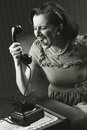 Angry woman screaming at retro phone Royalty Free Stock Photo