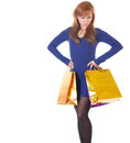 Angry woman with shopping bags over white background Royalty Free Stock Photo