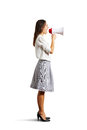 Angry woman shouting at megaphone isolated on white background Stock Images