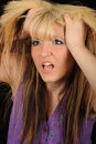 Angry woman tearing at hair Royalty Free Stock Photo