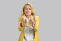 Angry young blonde gesticulating with thumbs. Royalty Free Stock Photo