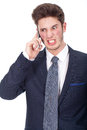 Angry young executive using cellphone closeup portrait on white background Stock Photo