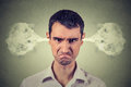 Angry young man, blowing steam coming out of ears Royalty Free Stock Photo