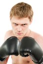 Angry young man in boxing gloves isolated on white Royalty Free Stock Image
