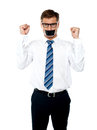 Angry young man with duct tape on his mouth Royalty Free Stock Images