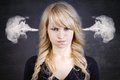 Angry young woman, blowing steam coming out of ears Royalty Free Stock Photo