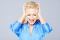 Angry young woman closing her ears Royalty Free Stock Photo