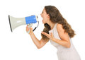 Angry young woman shouting through megaphone isolated on white Stock Photos