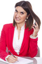 Angry young woman at work holding a cell phone Royalty Free Stock Photo