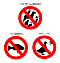 Animal Signs - No pets, fishing, feeding Stock Photo