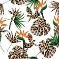 Animal skin leopard fill-in with tropical jungle and exotic leaves seamless pattern vector design for fashion ,fabric and all Royalty Free Stock Photo