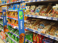 Animal treats in a pet store shelves of items consist mainly of dog food used to treat or train them Stock Image