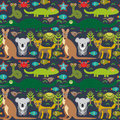 Animals Australia snake, turtle, crocodile, alliagtor, kangaroo, dingo. Seamless pattern on dark background. Vector