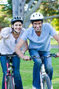 Animated couple riding a bike Stock Photography