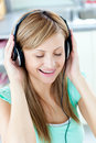Animated woman listening to music with headphones Stock Photography