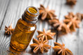 Anise oil in a bottle and stars Royalty Free Stock Photos