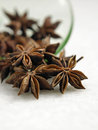 Anise star pouring out from green saucer Royalty Free Stock Photo