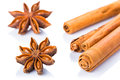 Anise stars and cinnamon sticks over white background Royalty Free Stock Photo