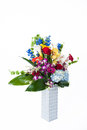 Aniversary bouquet lush holiday full of orchids roses and lillies in silver vase Royalty Free Stock Photography