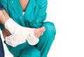 Ankle injury doctor bandaging man Royalty Free Stock Photography
