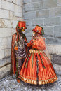 Annecy france february couple disguised beautiful orange costumes performing street annecy france venetian carnival which Stock Photos