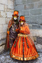 Annecy france february couple disguised beautiful orange costumes performing street annecy france venetian carnival which Royalty Free Stock Image