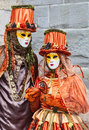 Annecy france february portrait couple disguised beautiful orange costumes performing street annecy france venetian carnival which Royalty Free Stock Images