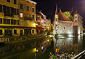 Annecy at night the palais de l isle and old houses france Stock Photography