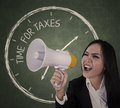 Announcement time for taxes businesswoman announcing using megaphone Royalty Free Stock Photos