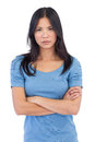 Annoyed asian woman with arms crossed on white background Stock Photography