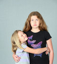 Annoyed big sister with little sister Royalty Free Stock Photography