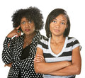 Annoyed mother and daughter black with teenage on isolated background Stock Images