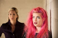 Annoyed parent and child girl in pink hair with upset Royalty Free Stock Photography