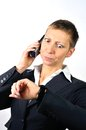 Annoyed woman with a phone blonde businesswoman is stressed Stock Photo