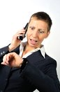 Annoyed woman with a phone blonde businesswoman and white background Royalty Free Stock Image