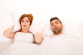 Annoyed woman portrait of an women awaken by her fiance s snoring Royalty Free Stock Photos