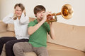 Annoying trumpet player Stock Photography