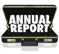 Annual report briefcase words financial statement in a black leather to illustrate a business or company filing or revenue summary Royalty Free Stock Photo