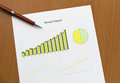 Annual report chart print, pen on desk. Royalty Free Stock Images