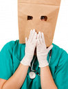 Anonymous frighten female doctor white background Stock Images