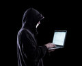 Anonymous hacker in the dark Royalty Free Stock Photo