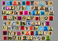 Anonymous letter letters and numbers cut out from old magazines and newspapers isolated on gray background in vector format Royalty Free Stock Images