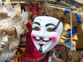 Anonymous mask among other masks in venice Royalty Free Stock Photography