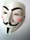 Anonymous mask or v for vendetta face or guy fawkes from the movie v for vendetta isolated on white background Royalty Free Stock Images