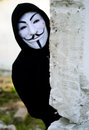Anonymous masked in black hoodie Stock Photos