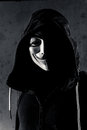 Anonymous an person with a hood on Stock Images