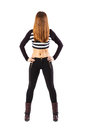 Anonymous standing slim woman with hair over face fit abdomen of a long brown isolated on white Stock Photo