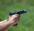Another in the chamber brass flies overhead as a handgun chambers round Royalty Free Stock Images
