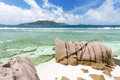 Anse banane la digue seychelles in with clear water and granite rocks Royalty Free Stock Images
